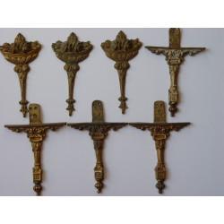 Cinco apliques de bronce de aproximadamente 12 cms. de altura.